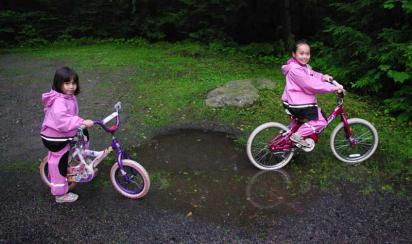 GettingOutside Kids Testing Puddlegear Rain Gear while Cycling