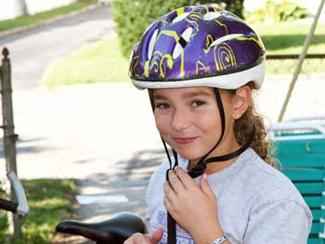 Smart Girl Wearing a Helmet and Adjusting the Strap