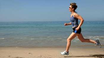 Woman Exercising Outdoors, Running on the Beach