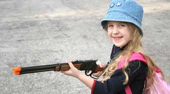 Girl with Toy Gun Playing Capture the Flag